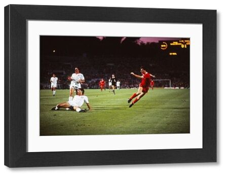 Football - 1984 European Cup Final - Liverpool 1* Roma 1 (*won 4-2 on pen a.e.t.)     Roma's Dario Bonetti grounded as Liverpool's Ian Rush shoots, at the Stadio Olimpico, Rome.     30/05/1984