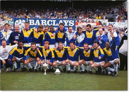 Football - 1991 / 1992 First Division - Leeds United 1 Norwich City 0 Leeds United's title-winning team celebrate with The Championship Trophy at Elland Road. Bottom row (left to right): Howard Wilkinson (Manager), Rod Wallace, Tony Dorigo, Gordon Strachan