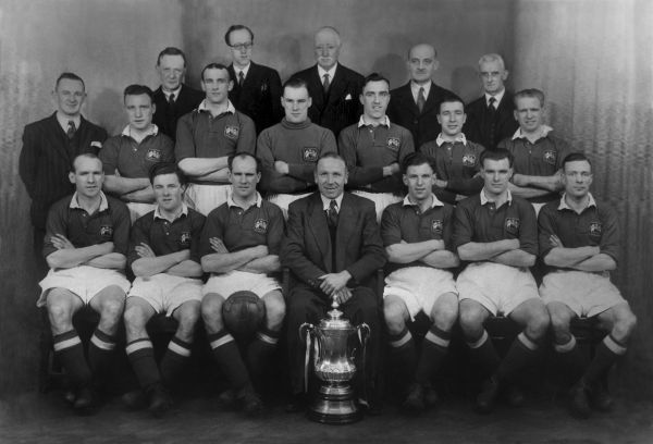 Football - 1947 / 1948 season Manchester United Team Group with Manager Matt Busby (Centre).  1948 FA Cup Winners, beat Blackpool 4-2 in the final. Back (left to right): W. H. Petheridge (Director), A. Gibson (Director), George Whittaker (Director), Dr