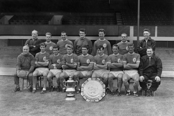 Football - 1965 Liverpool Summer Photocall (29/07/1965) Liverpool team group 1965 / 1966 1964 / 1965 FA Cup and Charity Shield winners   Back (left to right): R. Bennett (coach), Gordon Milne, Gerry Byrne, Tommy Lawrence, Chris Lawler, Ian St John