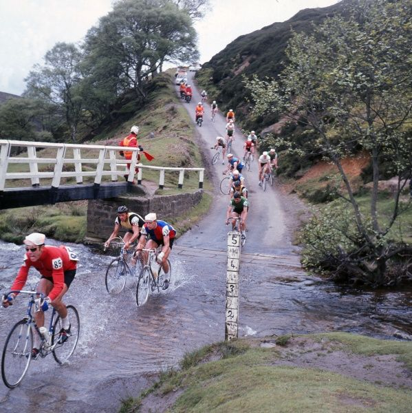 Road Cycling - 1969 Milk Race (Tour of Britain) - Stage Twelve: Scarborough (North Yorkshire) - South Shields (South Tyneside)  The riders cross a stream at Westerdale. Pictured are Switzerland's Ueli Sutter (#85), England's Martyn Roach (#16)