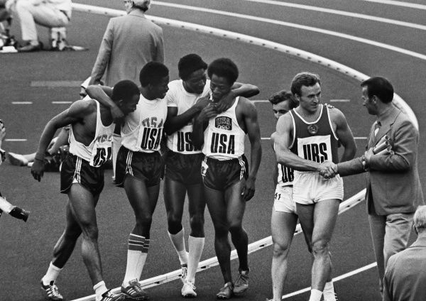 Athletics - 1972 Munich Olympics - Men's 4x100m Relay Final USA's gold medal-winning team celebrate at the end of the race in the Olympiastadion, Munich, West Germany