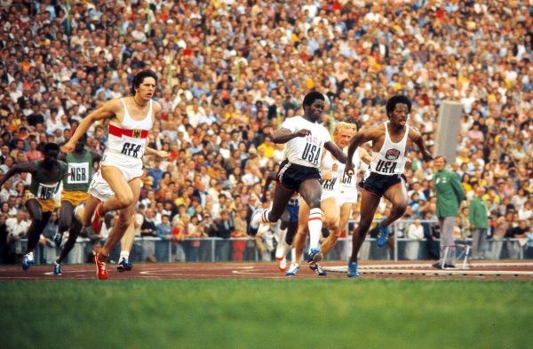 Athletics - 1972 Munich Olympics - Men's 4x100m Relay Semi-Finals Heat One Eddie Hart takes the baton from Gerald Tinker to run the final leg and win the heat for the USA in the Olympiastadion, Munich, West Germany. Also pictured, from left to right