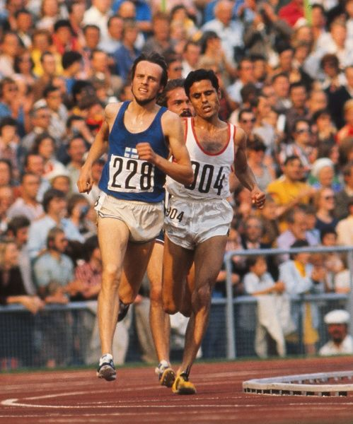 Athletics - 1972 Munich Olympics - Men's 5000m Final Finland's Lasse Viren (#228) and Tunisia's Mohammed Gammoudi (#904) during the race in the Olympiastadion, Munich, West Germany