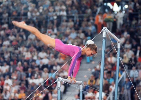 Gymnastics - 1972 Munich Olympics - Women's Uneven Bars Final East Germany's Karin Janz on the way to winning the gold medal in the uneven bars in the Sports Hall, Olympic Park, Munich, West Germany. Janz won the most gymnastics medals at the Munich Games