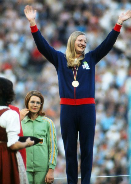 Athletics - 1972 Munich Olympics - Women's Pentathlon Medal Presentation Great Britain's gold medal winner Mary Peters on the podium in the Olympiastadion, Munich, West Germany. Left is West Germany's silver medal winner Heide Rosendahl