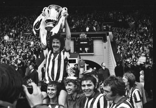 Football - 1973 FA Cup Final - Sunderland 1 Leeds United 0 Sunderland captain Bobby Kerr is chaired by his teammates as he lifts the trophy at Wembley. Below, left to right, Dennis Tueart, Jim Montgomery, Ian Porterfield and Ron Guthrie