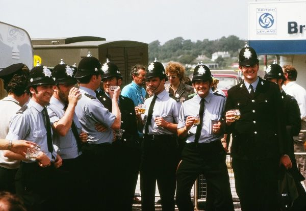 Road Cycling - 1974 Tour de France - Stage Two: Plymouth-Plymouth British 'bobbies' enjoy a beer before the start of the stage on the Plympton bypass