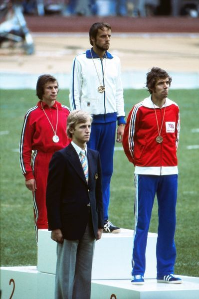 Athletics - 1976 Montreal Olympics - Men's 10,000m Medal Presentation From left to right, the bronze medalist Portugal's Carlos Lopes, gold medal winner Finland's Lasse Viren, and Great Britain's bronze medalist Brendan Foster