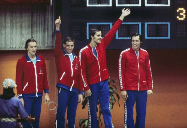 Swimming - 1976 Montreal Olympics - Men's 4 x 200m Freestyle Relay Medal Presentation Bronze medal winners the Great Britain team on the podium in the Olympic Pool, Quebec, Canada. Left to right, Alan McClatchey, David Dunne, Gordon Downie