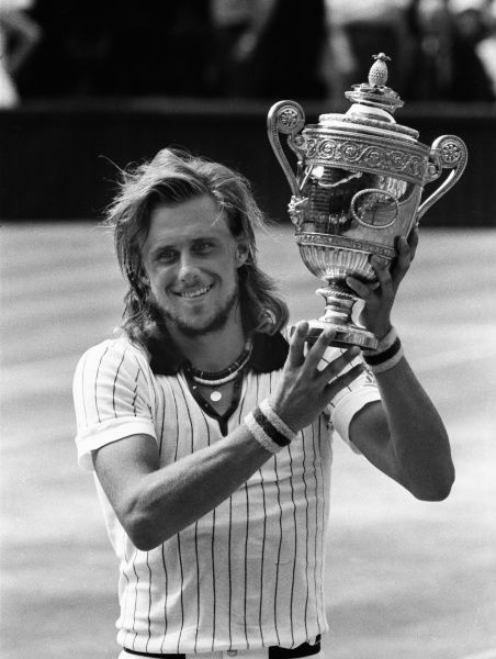Tennis - Wimbledon Championships 1976 Borg v Nastase. Centre Court. Bjorn Borg with the Mens Singles trophy. Credit : Colorsport / Andrew Cowie