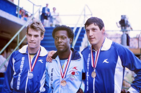 Athletics - 1982 Brisbane Commonwealth Games - Men's 200m Presentation Ceremony Scotland's Allan Wells (right) and England's Mike McFarlane (centre) with their gold medals after their dead heat and Scotland's Cameron Sharpe with his bronze in the QEII Stadium