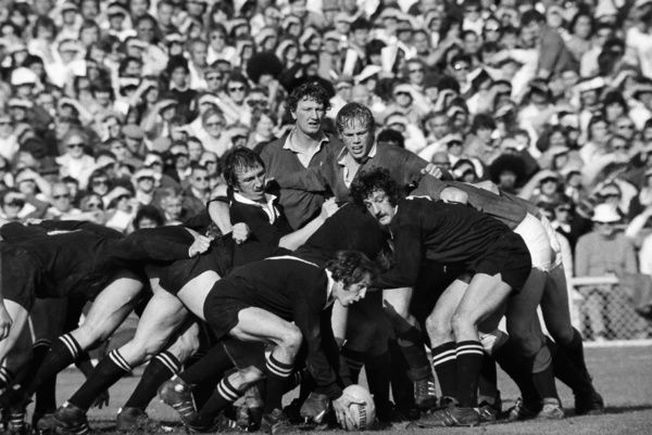 Rugby Union - 1977 British Lions Tour of New Zealand - Fourth Test: New Zealand 10 British Lions 9     Peter Wheeler and Willie Duggan of the Lions look on as All Black scrum-half Lyn Davis gathers the ball from a scrum, at Eden Park, Auckland