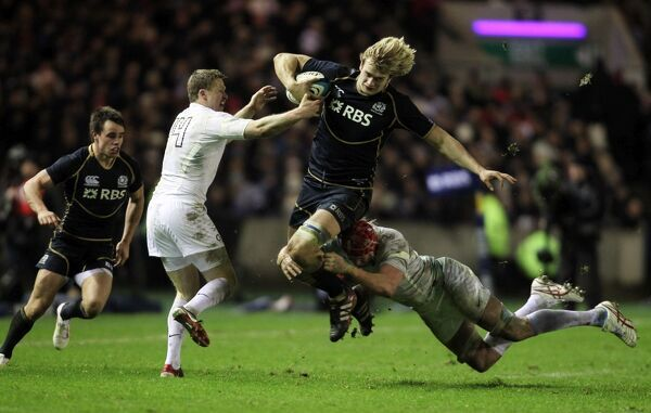 Rugby Union - Six Nations Championships - Scotland vs. England   EDINBURGH, SCOTLAND - FEB 04: Mouritz Botha of England tackles Richie Gray of Scotland during the Scotland vs England RBS Six Nations Championship at Murrayfield Stadium on Feb 4th
