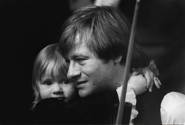 Alex Higgins (with his daughter. Lauren) after the Final. Alex Higgins v Steve Davis. Embassey World Snooker Championships 1983. Credit : Colorsport