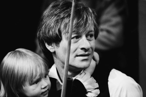 Alex Higgins with his daughter Lauren after his semi-final defeat to Steve Davis (16-5) in the 1983 Embassy World Snooker Championship Crucible Theatre, Sheffield Credit : Colorsport / Stewart Fraser