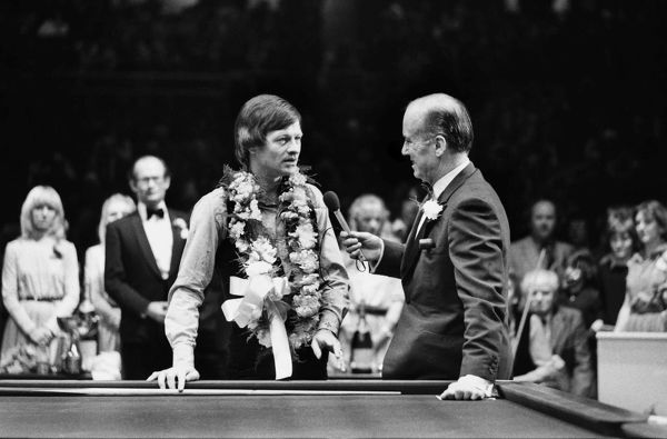 Snooker - Benson and Hedges Masters 1981 - Wembley  Tournament winner Alex Higgins talks with TV Presenter Peter West after defeating Terry Griffiths 9-6