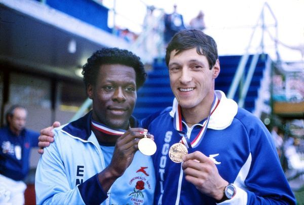 Athletics - 1982 Brisbane Commonwealth Games - Men's 200m Presentation Ceremony Scotland's Allan Wells (right) and England's Mike McFarlane with their gold medals after their dead heat in the QEII Stadium, Queensland, Australia.  Both Wells