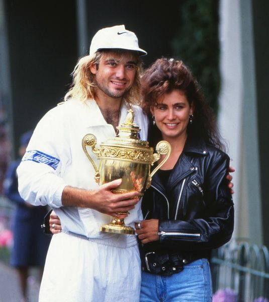 Tennis - 1992 Wimbledon Championships The Men's Singles Champion Andre Agassi with the trophy, alongside his girlfriend Wendy Stewart