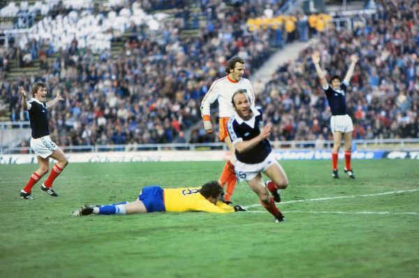 Football - 1978 World Cup - Group Four: Scotland 3 Netherlands 2 Scotland's Archie Gemmill celebrates his famous solo goal, with teammate Kenny Dalglish, left, and grounded goalkeeper Jan Jongbloed, centre, at the Estadio Ciudad de Mendoza, Mendoza