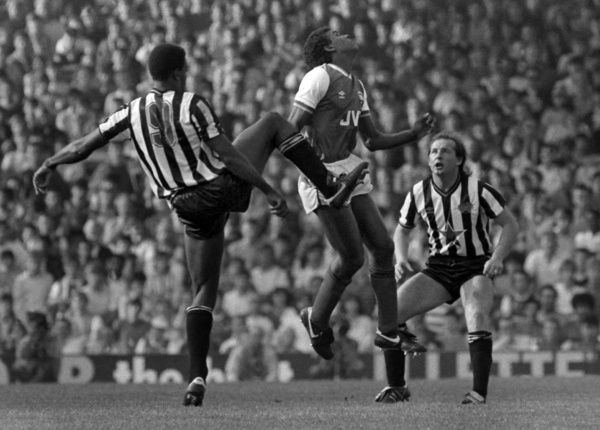 Football - 1985 / 1986 First Division - Arsenal 0 Newcastle United 0     David Rocastle of Arsenal and Tony Cunningham (#9) and David McCreery of Newcastle, at Highbury.     It was Rocastle's first team debut.     28/09/1985