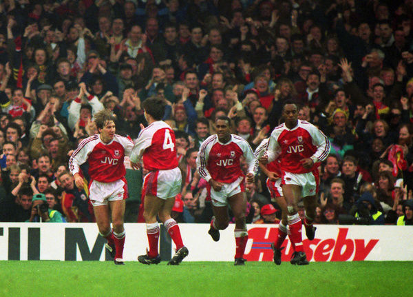Football - 1991 / 1992 First Division - Arsenal 1 Manchester United 1     (l-r): Paul Merson. David Hillier (#4), David Rocastle, and Ian Wright celebrate Rocastle's goal, at Highbury.     01/02/1992