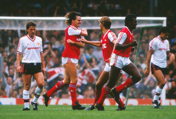 Football - 1986 / 1987 First Division - Arsenal 1 Manchester United 0     Arsenal's Charlie Nicholas celebrates his goal with Tony Adams, with David Rocastle, right, at Highbury.     23/08/1986