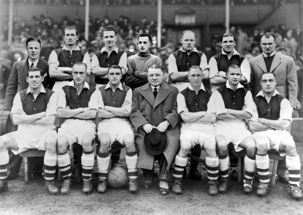 Football - 1937 / 1938 season - Arsenal Team Group Back (left to right): Sidney Cartwright, William Crayston, Herbert Roberts, Frank Boulton, George Male, Ted Drake, Tom Whittaker (trainer).  Front row: Alfred Kirchen, George Hunt, Eddie Hapgood