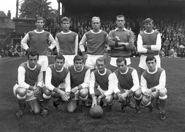 Football - 1964 / 1965 season - Arsenal Team Group Back (left to right): Geoff Strong, Gordon Ferry, Don Howe, Jim Furnell, William 'Billy' McCullough.  Front: Alan Skirton, Terry Neill, Joe Baker, George Eastham, David Court, George Armstrong