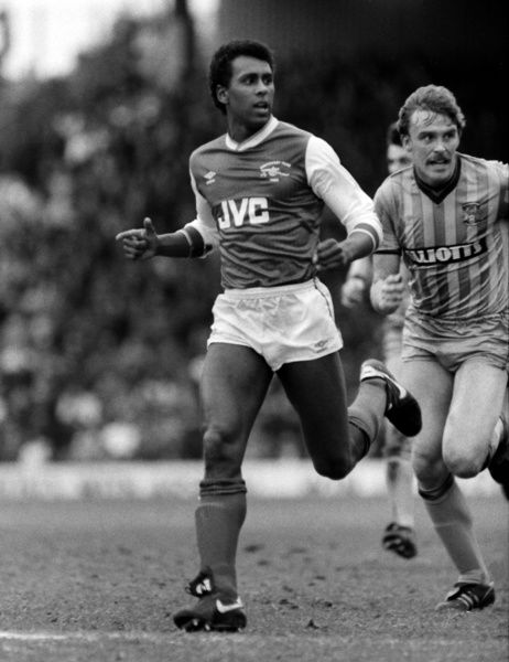Football - 1985 / 1986 First Division - Arsenal 3 Coventry City 0     David Rocastle of Arsenal and Brian Kilcline of Coventry City, at Highbury.     22/03/1986
