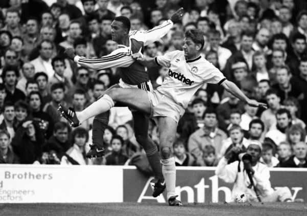 Football - 1989 / 1990 First Division - Arsenal 4 Manchester City 0     David White of City challenges David Rocastle, at Highbury.     14/10/1989     This was the only game that City ever played in this yellow kit