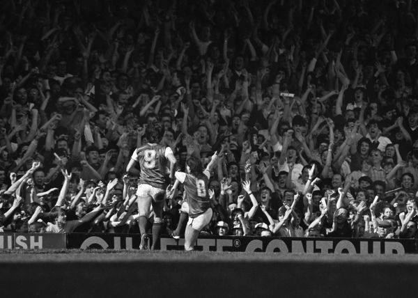 Charlie Nicholas (8) celebrates his goal with the Arsenal fans in the North Bank. Paul Mariner (9) joins in. Arsenal v Tottenham Hotspur, 21/04/1984. Credit: Colorsport / Andrew Cowie