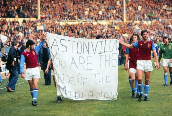 Football - 1977 League Cup Final - Aston Villa 0 Everton 0 Villa's John Robson and Chris Nichol (right) with a banner thanking their fans after the first final ended in a draw at Wembley