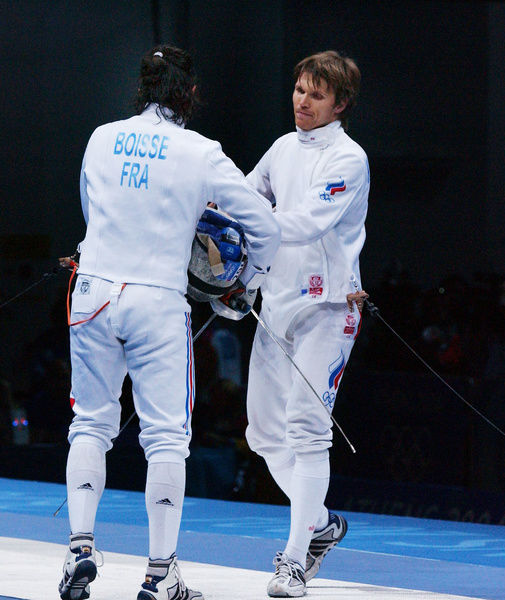 Fencing - 2004 Athens Olympics - Men's Epee Individual, Final Pool Bronze-Medal Match     Pavel Kolobkov (Russia) vs. Eric Boisse (France)     Kolobkov (#210) shakes hands with his opponent after winning the bronze medal, at the Olympic Fencing Hall