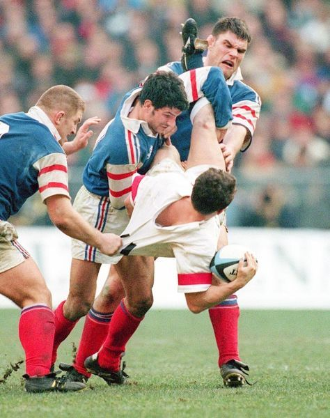 Rugby Union - 1998 Six Nations - France 24 England 17 England wing Austin Healey is tackled by France's Franck Tournaire, Marc Lievremont and Fabien Pelous at the Stade de France, Paris