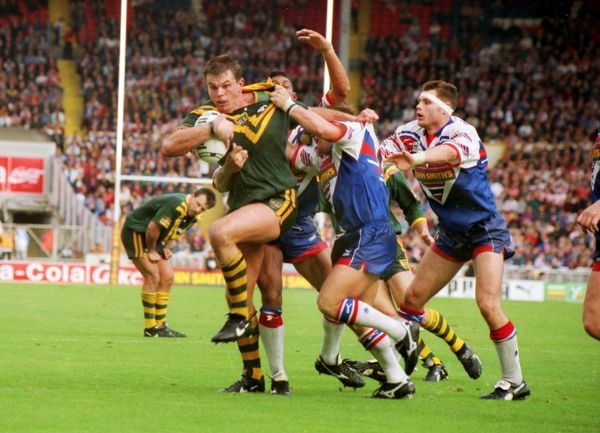 RUGBY LEAGUE Australia's Paul Harragon is tackled by several Great Britain defenders