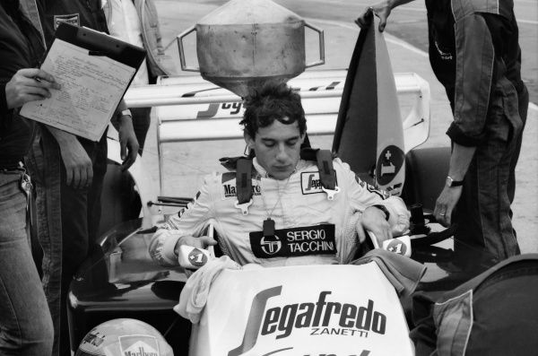 Motorsport - Formula One F1 World Championships - 1984 British Grand Prix Practice Aryton Senna gets into his Toleman-Hart Car at Brands Hatch