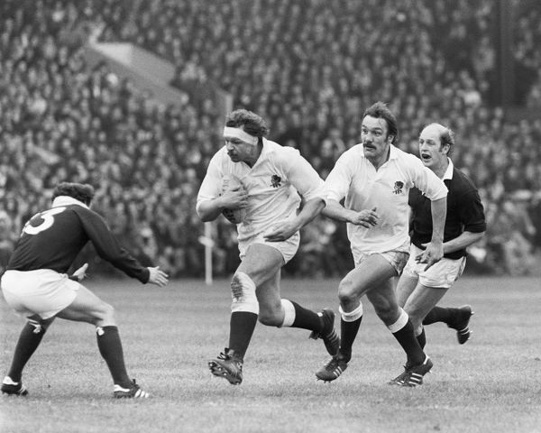 BILL BEAUMONT (ENG) BEARS DOWN ON JIM RENWICK WITH Roger UTTLEY AND Fran COTTON IN SUPPORT