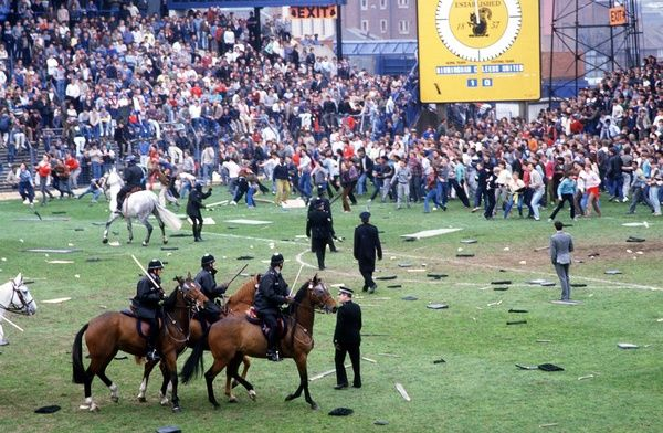 The fans of Birmingham and Leeds riot on the pitch as the Police try in vain to control them. Birmingham City v Leeds United, 11/5/85. Credit: Colorsport