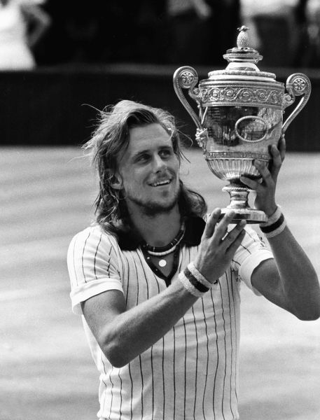 Tennis - 1976 Wimbledon Championships - Men's Singles Final Bjorn Borg lifts the trophy on Centre Court after defeating Ilie Nastase. It was Borg's first Wimbledon title