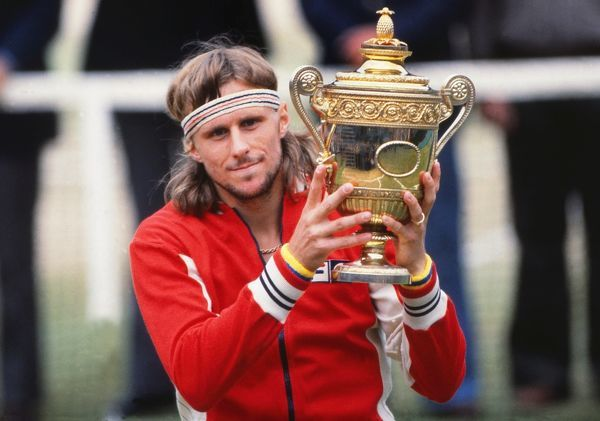 Tennis - 1978 Wimbledon Championships - Men's Singles Final Bjorn Borg celebrates with the trophy after his 6-2 6-2 6-3 victory over Jimmy Connors on Centre Court. It was Borg's third Wimbledon title