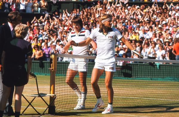Tennis - 1977 Wimbledon Championships - Men's Singles Final Bjorn Borg celebrates at the net after beating Jimmy Connors (left) on Centre Court