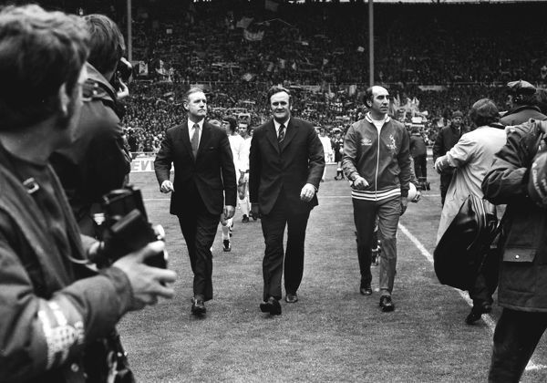 Bob Stokoe (Sunderland Manager) and Don Revie (Leeds Manager) lead out their teams onto the Wembley pitch. FA Cup Final 1973 Leeds United v Sunderland 05/05/1973 Wembley. Credit : Colorsport