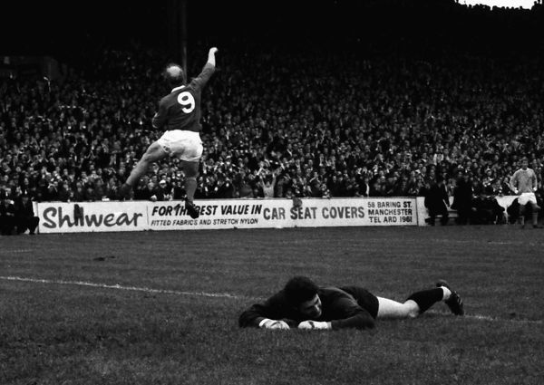 Ken Mulhearn (goalkeeper) - Manchester City is grounded as Bobby Charlton (Manchester United) celebrates his goal. Manchester City v Manchester United; 30/09/1967.  Credit: Colorsport
