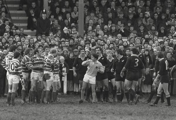 Rugby Union - 1978 All Black Tour of Britain and Ireland - Bridgend 6 New Zealand 17 Referee L. Prideaux (England) talks to both sides before a scrum at Brewery Field, Bridgend