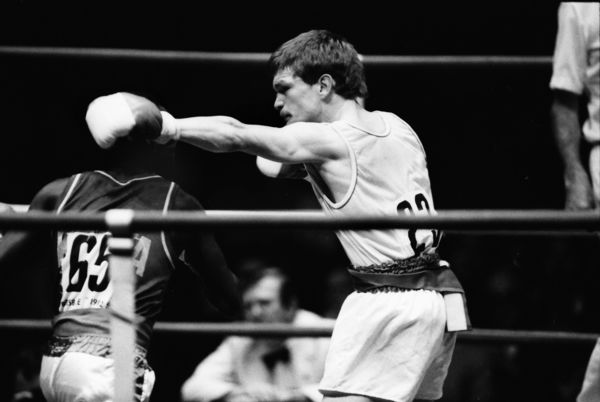 Boxing - 1982 Brisbane Commonwealth Games - Men's Light Flyweight [48kg] Final: John Lyon (England) vs. Abraham Wachire (Kenya) John Lyon on the attack on the way to the silver medal