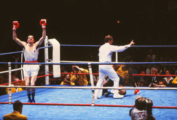 Boxing - 1982 Brisbane Commonwealth Games - Men's Middleweight [75kg] Final: Jimmy Price (England) vs. Sam Douglas (Australia) Jimmy Price celebrates after knocking down Douglas to win the gold medal, as the referee moves in to stop the contest