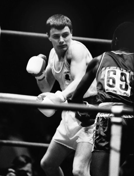 Boxing - 1982 Brisbane Commonwealth Games - Men's Lightweight [60kg] Final: James McDonnell (England) vs. Hussein Khalili (Kenya) England's James McDonnell on the way to winning the silver medal