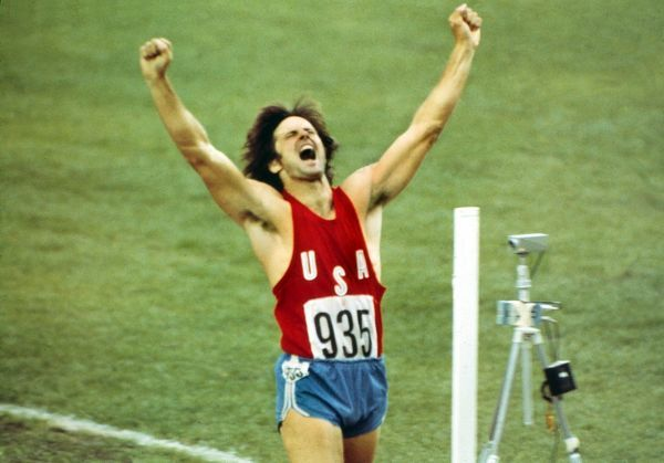 Athletics - 1976 Montreal Olympics - Decathlon Day Two The USA's Bruce Jenner celebrates as he crosses the finish line in the final event, the 1500m, to win the gold medal in a new World Record in the Olympic Stadium, Olympic Park, Quebec