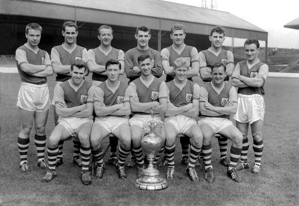 Football - First Division 1960 / 1961 - Burnley Team Group The League Champions pictured with the trophy. Back (left to right): Alex Elder, J Robson, Tommy Cummings, Adam Blacklaw, Brian Miller, J Angus, Trevor Meredith.  Front: John Connelly